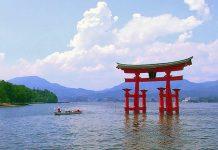 Travel Japan - A Japanese torii at dusk at Itsukushima Shrine