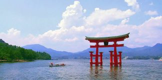 Travel Japan - A Japanese torii at dusk at Itsukushima Shrine